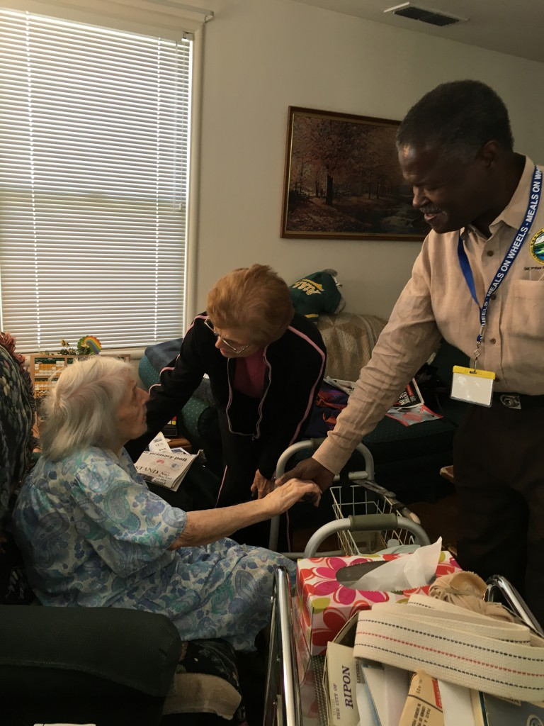 Federal Glover delivers a meal to senior Ethel