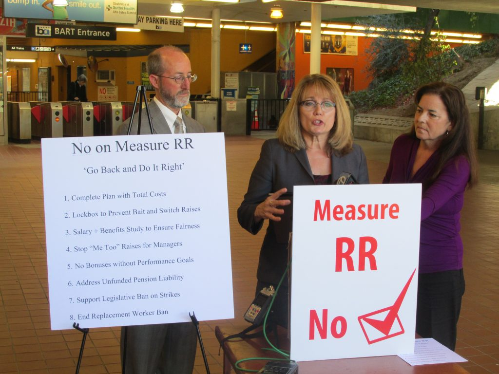 BART Director candidate Debora Allen speaks at a news conference to oppose BART bond Measure RR, as State Senator Steve Glazer and fellow candidate Jennifer Hostermann listen at the Lafayette BART Station on Wednesday, October 26, 2016. Photo special to the Herald.