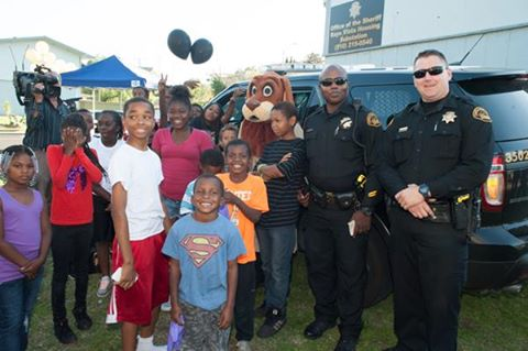 Kids and Sheriff's Deputies, with McGruff the Crime Dog help celebrate the grand opening of the new sub-station in Rodeo on Wednesday, October 26, 2016. Photo courtesy of CCCSheriff.