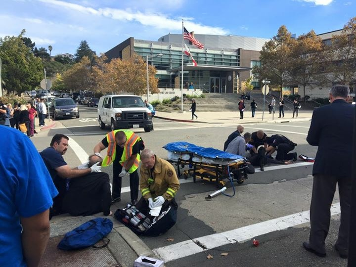 Martinez Police Officers, County Sheriff Deputies and ConFire personnel attend to three victims of a hit and run, at the intersection of Court and Main Streets in Martinez, Monday morning, November 7, 2016. Photo by Angrett Davies