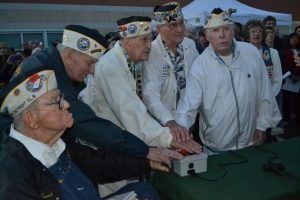 Pearl Harbor survivors push the button to light the beacon atop Mt. Diablo last year.